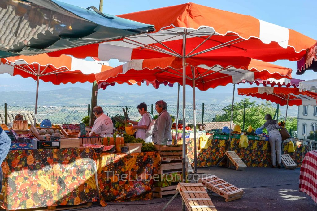 Bonnieux Friday morning market with parasols