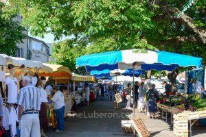 People walking around Bonnieux Friday morning market