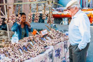 Garlic seller at Tuesday market, Gordes