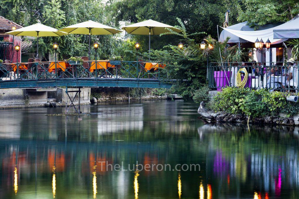 Restaurant on bridge in L'Isle-sur-la-Sorgue