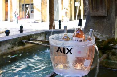 Aix rosé bottles in a fountain