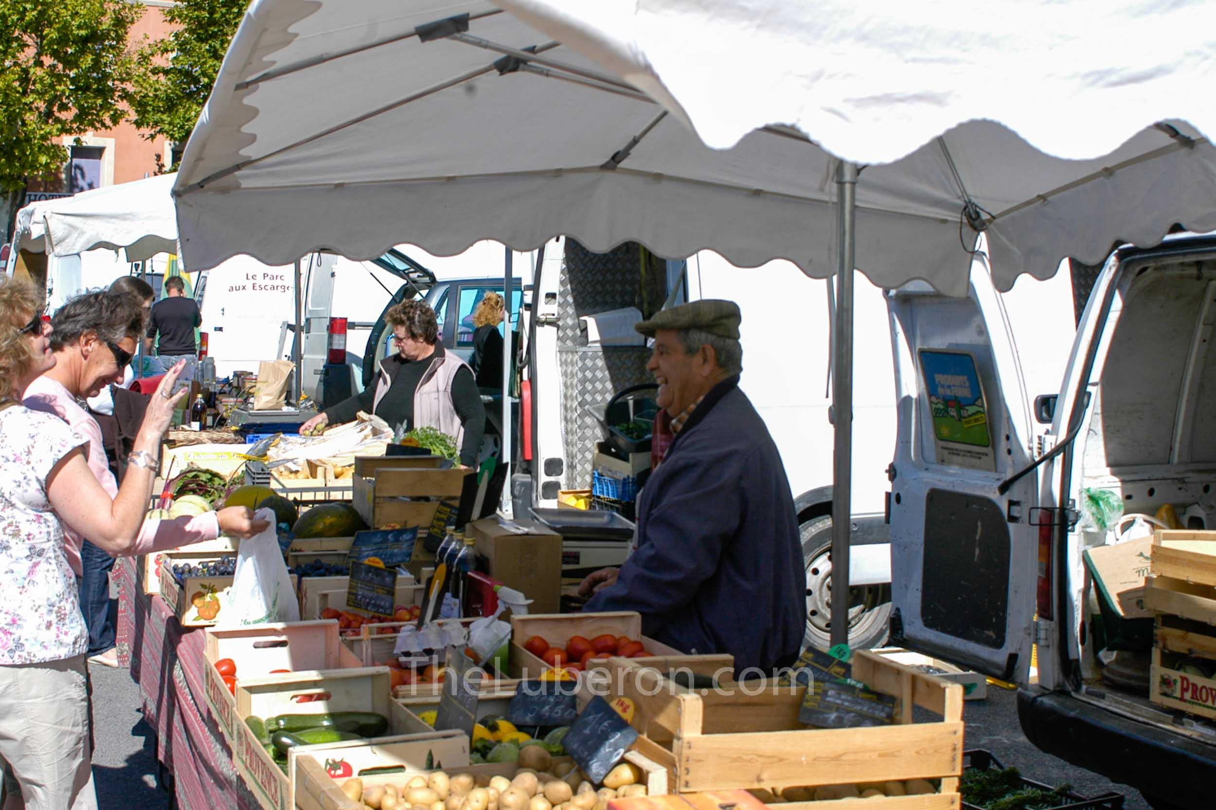 Stallholder at Apt market
