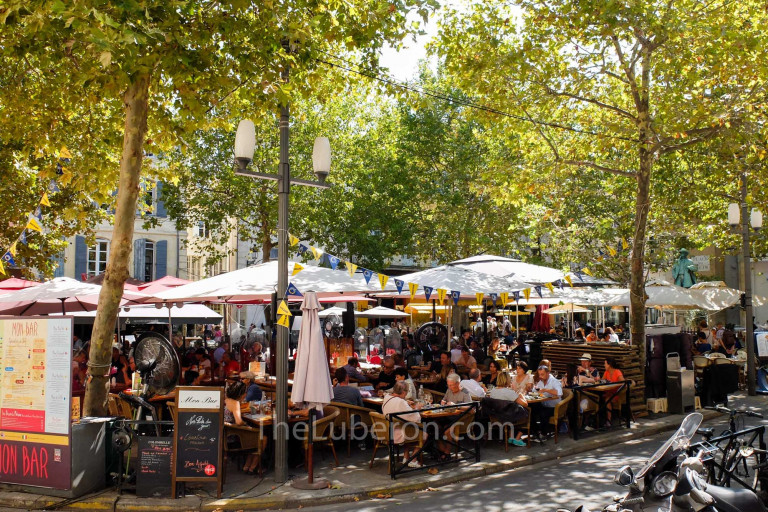 A square with restaurants in Arles