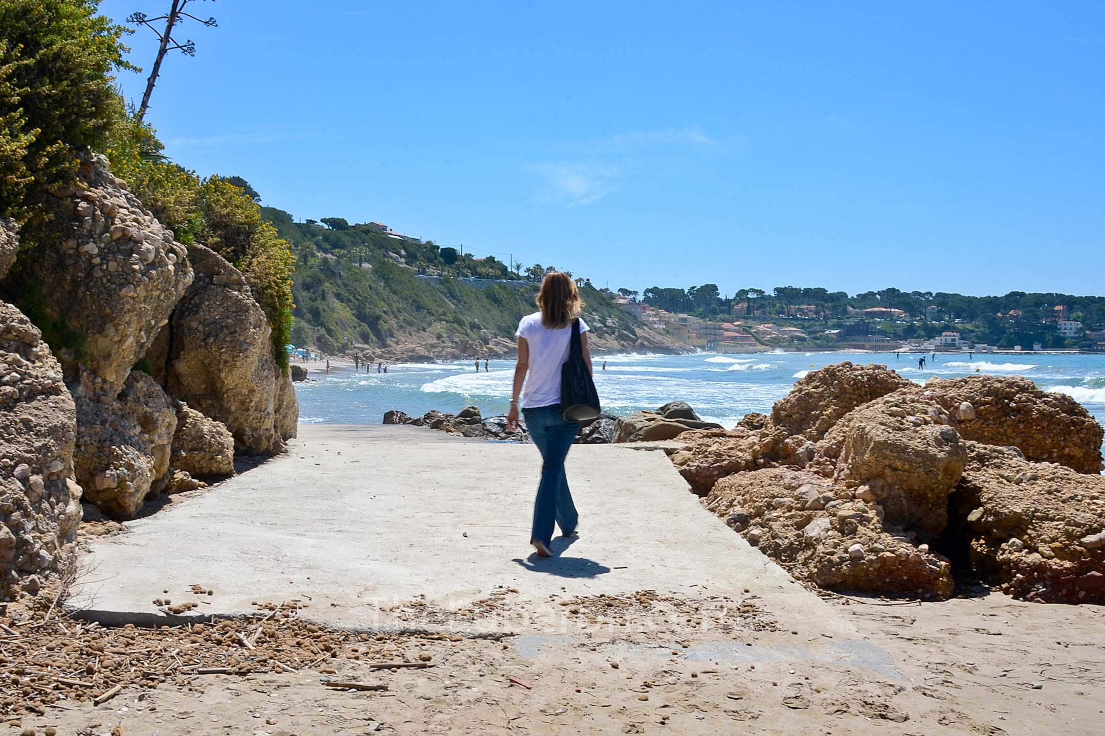Woman walking beach at Bandol