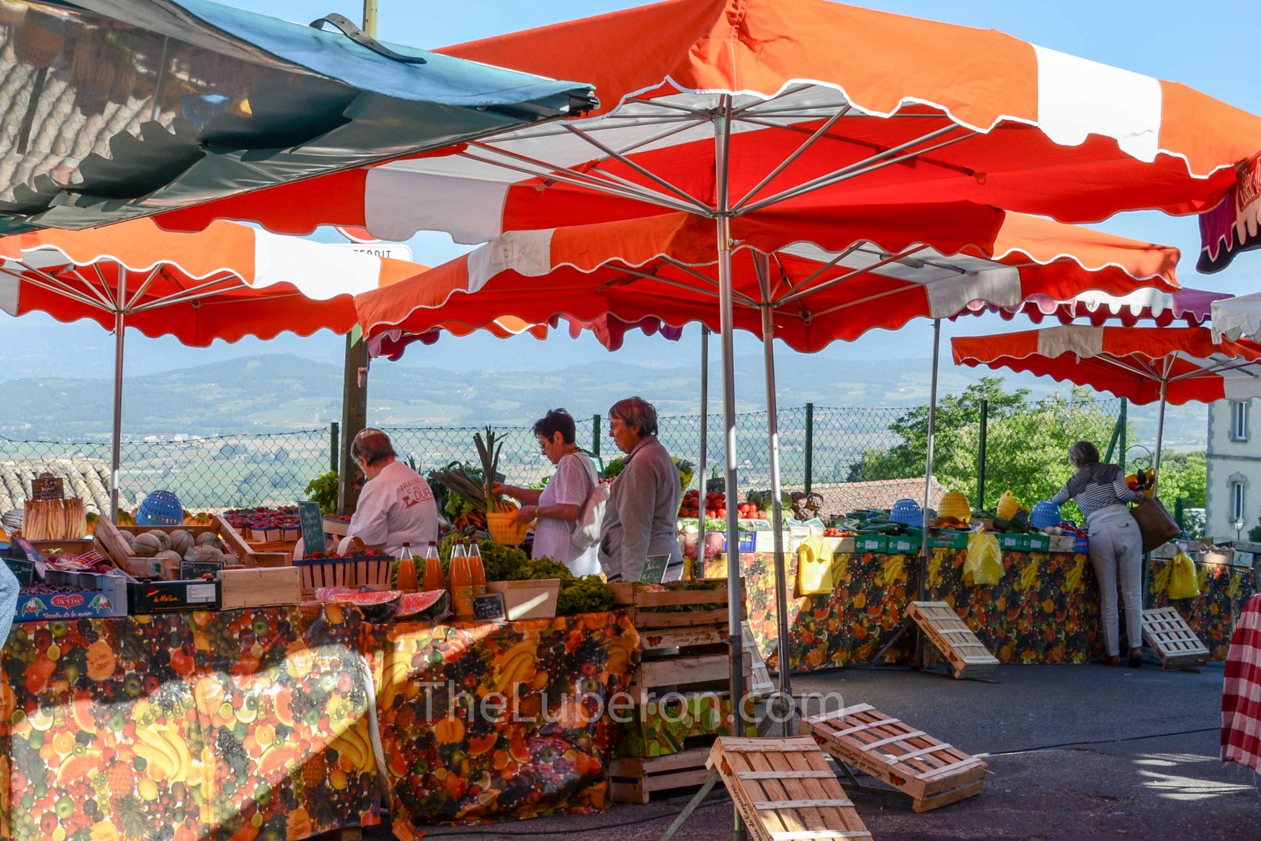 Colourful parasols at Bonnieux market