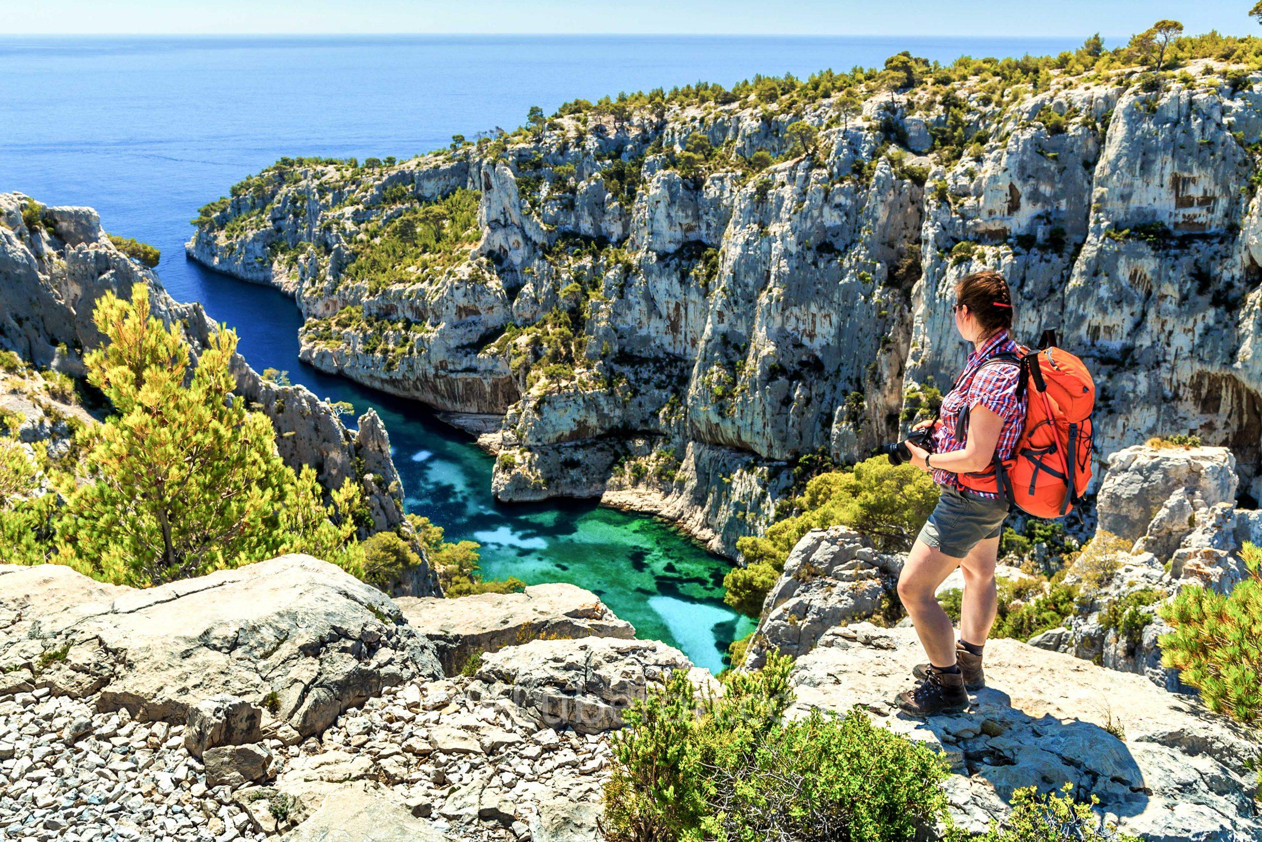 Hiker looking down at Calanque d'En-Vau