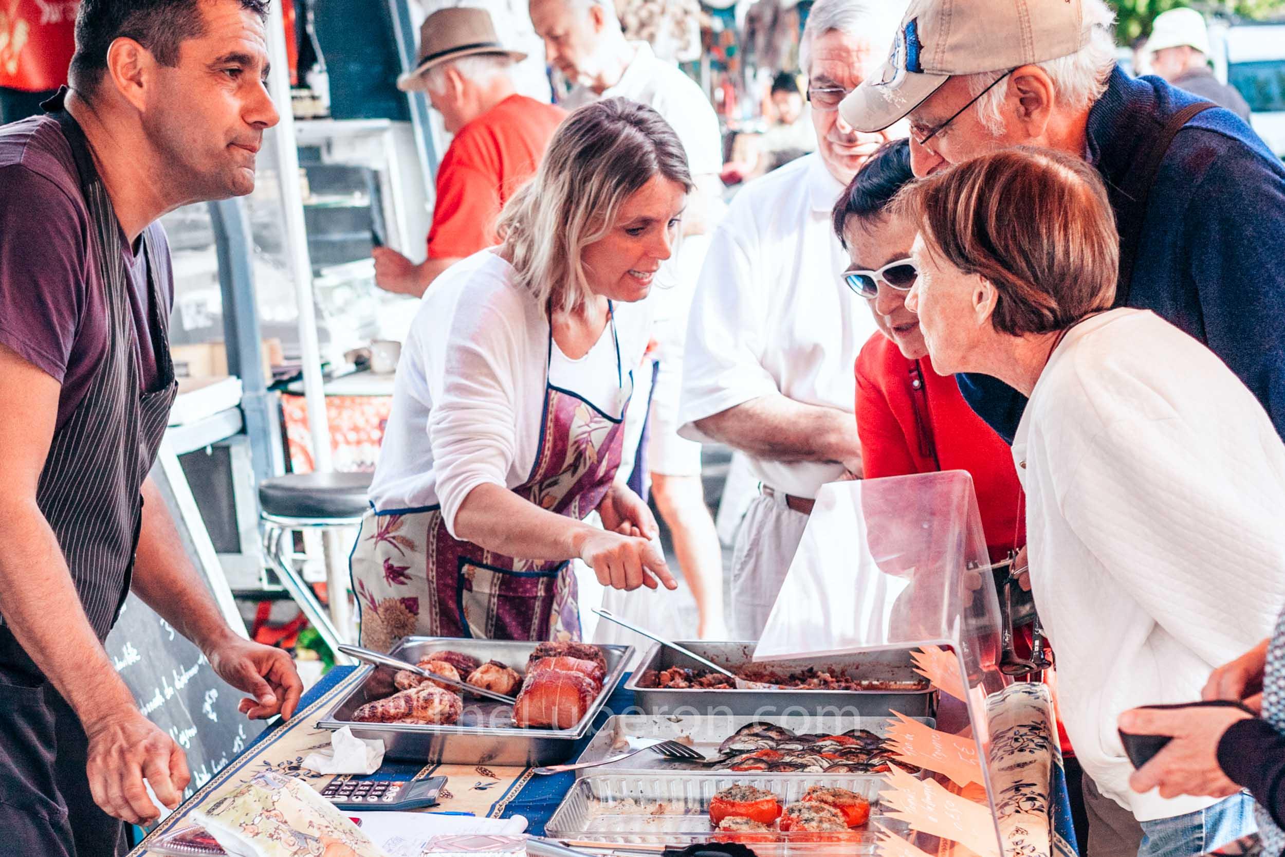 Cooked food at Gordes market