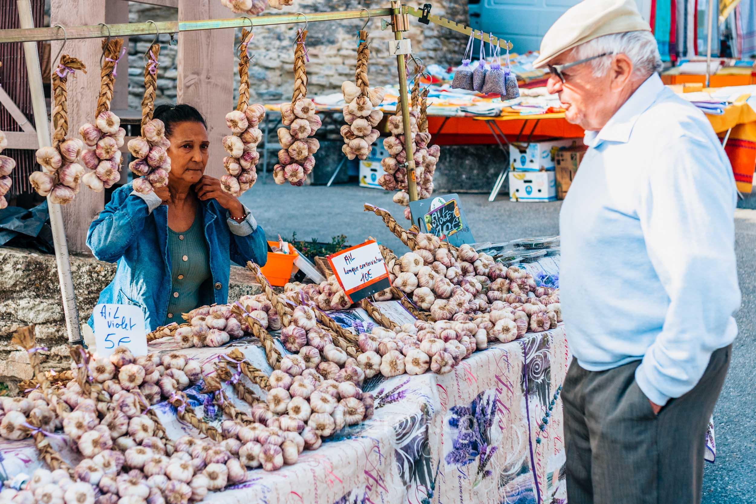 Garlic seller at Gordes market