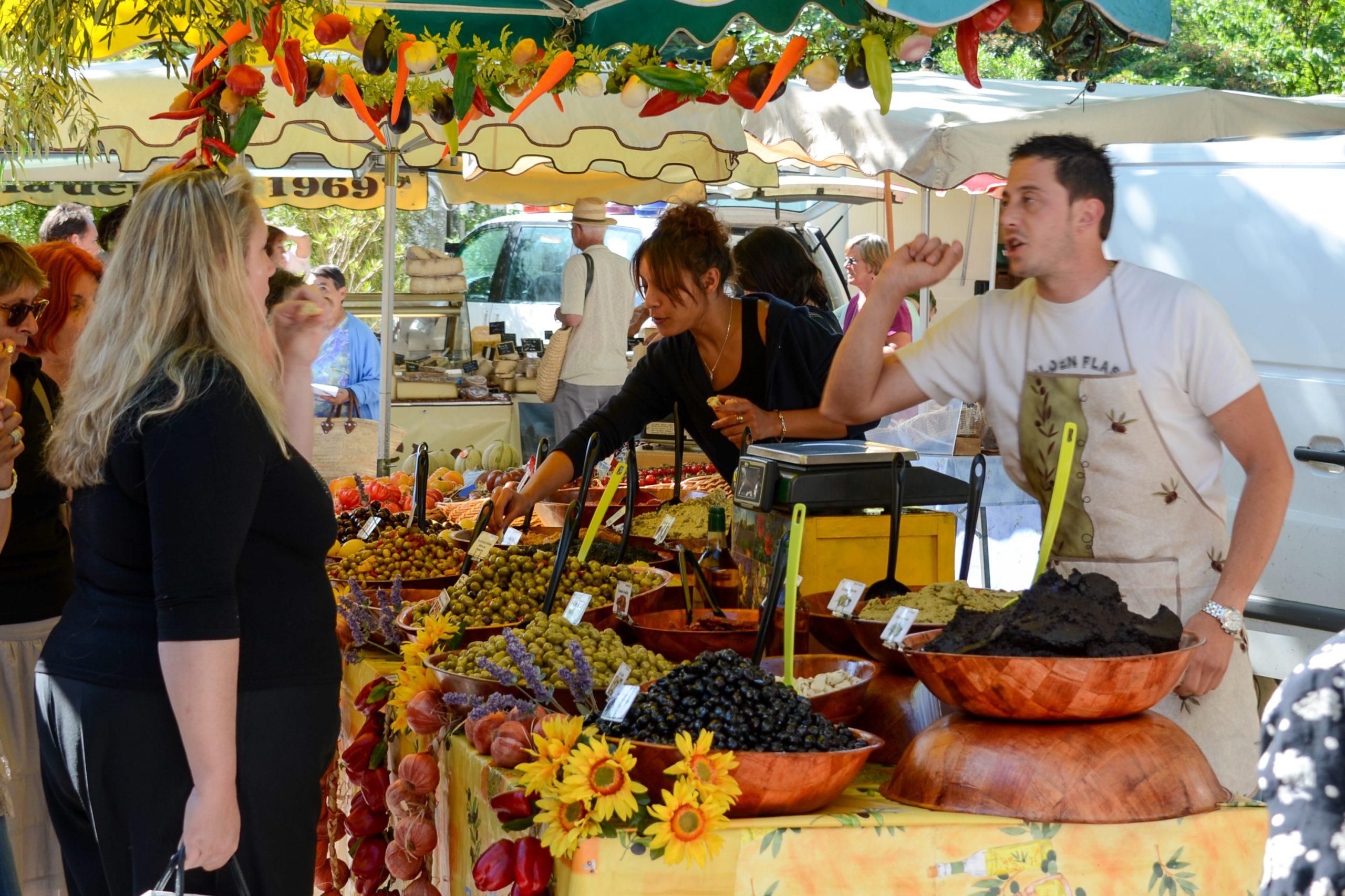 Olive seller at Lourmarin market