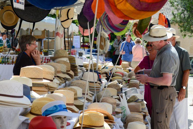Hat seller at Lourmarin market