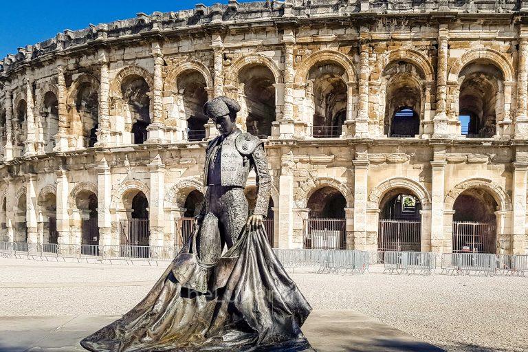 Statue outside Nimes amphitheatre